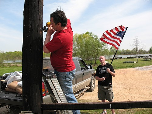 Jerry and Dave install an American flag at gate