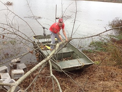 Hudson Wilson (Manager Wilson's grandson) adding tree structure to Sturdivant Lake...Dec. 2012